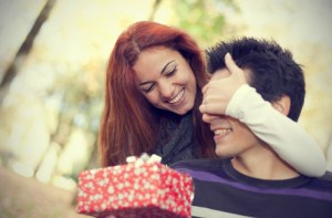 girl-surprising-her-boyfriend-with-gift